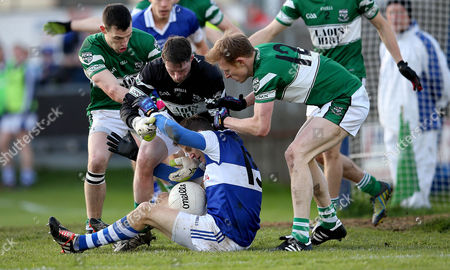 Stock Photo of Portlaoise's Paul Cotter, goalkeeper Micky Nolan and Brian Glynn tackle Tomas Quinn of Vincents