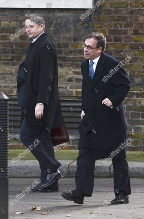 Britain's most senior civil servant, Sir Jeremy Heywood (left) arriving for work having car shared with David Cameron's Chief of Staff Ed Llewellyn