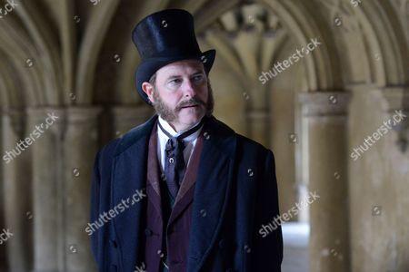 Risteard Cooper as Sir Henry.