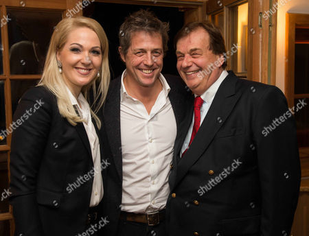Stock Image of Kathrin Glock, Hugh Grant and Michael Aufhauser