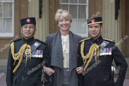 Emma Thompson seen talking to two Gurkas after her mother Phyllida Law received her OBE for services to Drama and for charitable services