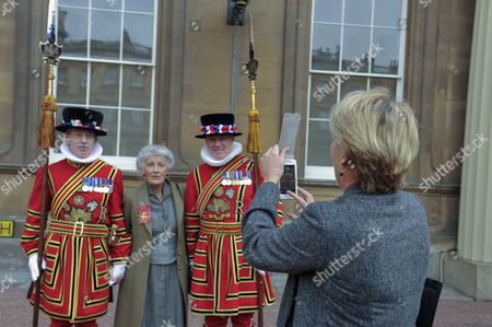Phyllida Law seen after receiving her OBE for services to Drama and for charitable services while daughter Emma Thompson photographs her