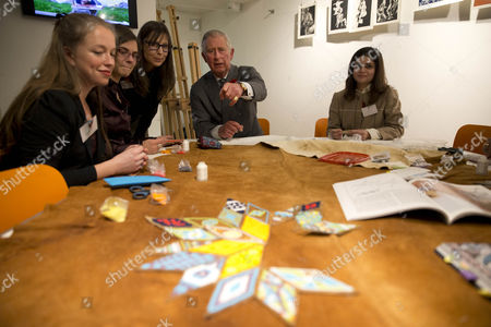Prince Charles chats to Associate Professor Judy Anderson and students of the Prince's School of Traditional Arts demonstrating beading and quilling to him