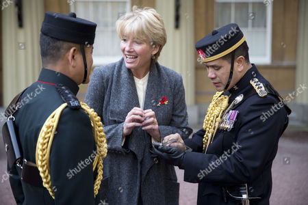 Emma Thompson talks to two Gurkhas whilst visiting Buckingham Palace where her mother Phyllida Law was awarded the OBE ror services to Drama and for charitable services.