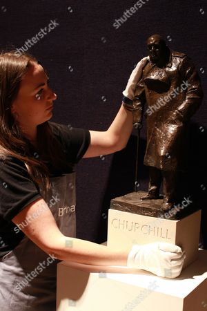 Porter Rebecca Holman with Winston Churchill maquette for monument in Parliament Square by Ivor Roberts-Jones
