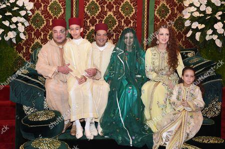 King Mohammed VI of Morocco poses with Crown Prince Moulay Hassan, Princess Lalla Salma and Princess Lalla Khadija during the wedding ceremony of Prince Moulay Rachid of Morocco and Lalla Oum Keltoum at Rabat Royal Palace
