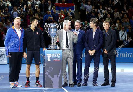 Novak Djokovic of Serbia celebrates ending the year with the World No.1 Ranking with Boris Becker, John McEnroe, Carlos Moya, Mats Wilander and Chris Kermode at the ATP World Tour Finals, London, 2014