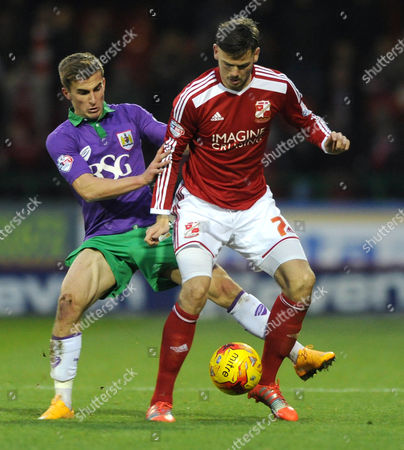 Bristol City's Joe Bryan closes down Swindon Town's Ben Gladwin