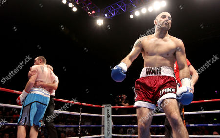 Gary 'Spike' O'Sullivan (red shorts) celebrates a first round knockout against Anthony Fitzgerald (blue shorts)