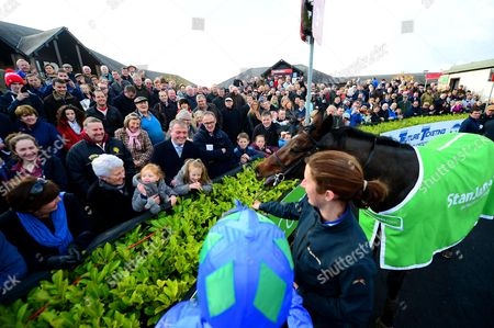 PUNCHESTOWN. The Stanjames.com Morgiana Hurdle. The winner HURRICANE FLY meets jockey RUBY WALSH'S children ELSA and ISABELLE with their grandmother Helen Walsh after his 20th Grade One win.