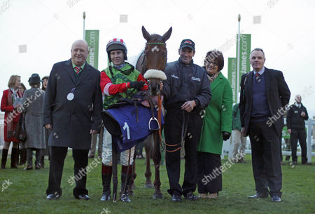 DEFINITLY RED (Richard Johnson) with owner Phil Martin and trainer Steve Gollings after The High Sheriff Of Gloucestershire's Standard Open National Hunt Flat Race Cheltenham