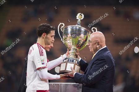Mattia De Sciglio gets Luigi Berlusconi Trophy from Adriano Galliani (Milan)