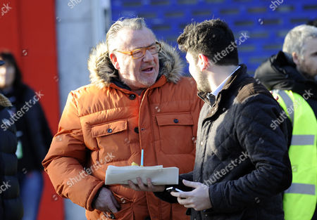 Ray Winstone poses for a member of the public but turns down his offer of a chip.