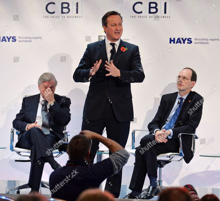 Pm David Cameron (centre) Speaks At Conference With Cbi President Sir Michael Rake (l) And Cbi Dir. Gen John Cridland . - Cbi (confederation Of British Industries)conference At The Hilton Metropole Hotel London. -.