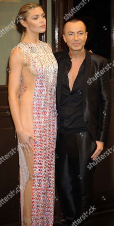 Abigail Clancy Models Dress On Steps Of Dorchester Hotel In London Tonight For Fashion For The Brave. With Designer Julien MacDonald.