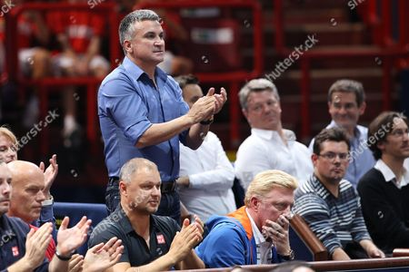 Srdjan Djokovic (Standing), the father of Novak Djokovic of Serbia and his Geman coach Boris Becker (Front Right) watch his match