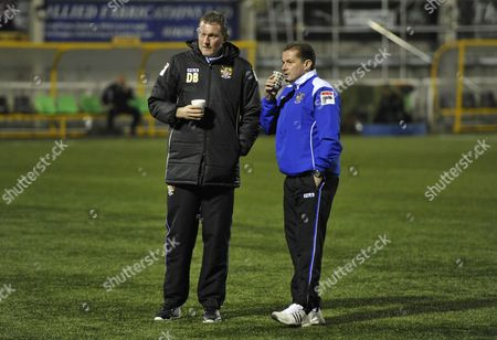 Stevenage FC Manager Graham Westley (right) and goalkeeping coach Dave Beasant talk on the 3G surface at the Gallagher Stadium, home of Maidstone United