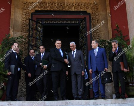 Stock Picture of Rachid Talbi Alami shakes hands with, Tunisian Prime Minister Mehdi Jomaa in Rabat