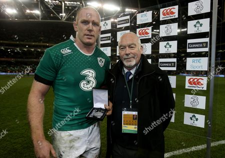 Stock Photo of Ireland's Paul O'Connell receives the Guinness Series man of the match award from Peter Coyle