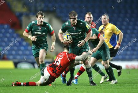 Brad Thorn of Leicester Tigers is tackled by Seb Jewell of London Welsh