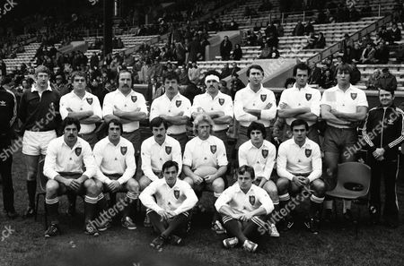 Rugby Union - 1980 Five Nations Championship - Scotland 22 France 14 France team group before kick-off at Murrayfield on . Back Row: M Reddan (Touch-judge -IRFU) (half out of shot), John West (Referee - IRFU), Philippe Dintrans, Armand Vaquerin, Robert Paparemborde, Michel Clémente, Jean-Luc Joinel, Francis Haget, Jean-François Marchal, Tony O?Sullivan (Touch-judge - IRFU). Seated: Daniel Bustaffa, Roland Bertranne, Serge Gabernet, Jean-Pierre Rives (captain), Didier Codorniou, Jean-Luc Averous In front: Alain Caussade, Jérôme Gallion.