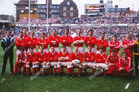 Rugby Union - 1989 Five Nations Championship - Wales 12 England 9 Wales team group before kick-off at Cardiff Arms Park on . Back: Jim Fleming (Touch-judge - SRU), David Bryant, Kevin Moseley*, Arthur Emyr, Mike Griffiths, Phil Davies, Bob Norster, Mark Jones, Gary Jones, Laurance Delaney, Phil John*, Hugh Williams-Jones*, Kerry Fitzgerald (Referee - ARU). Seated: Jonathan Griffiths*, Ieuan Evans, Mike Hall, David Evans, Ian Watkins, Paul Thorburn (captain), Paul Turner, Robert Jones, Carwyn Davies*, Bleddyn Bowen*. * - indicates a replacement