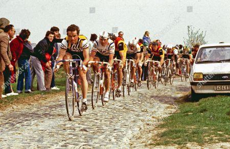 Stock Picture of Paris - Roubaix - Bernard Hinault, followed by Hennie Kuiper, Johan Vandervelde, Gilbert Duclos-Lassell, Jan Raas, Ludo Peeters, Jonathan Boyer and Dirk Dewolf.