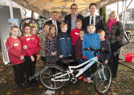 Robert Goodwill, Transport Minister, Matt Davies, Halfords CEO and Nick Clegg at the Halfords Big Bike Revival and Kids Bike Workshop with
