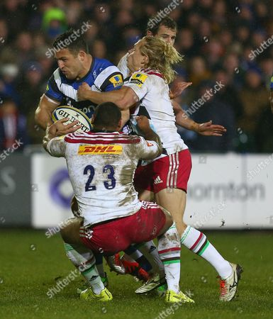 Sam Burgess of Bath Rugby is tackled by Jordan Turner-Hall of Harlequins