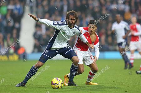 West Bromwich Albion's Georgios Samaras battles with Arsenal's Alexis Sanchez