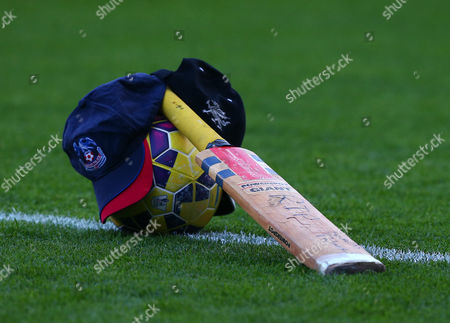 A cricket bat lies on the pitch in tribute to Australian cricketer Philip Hughes who died this week