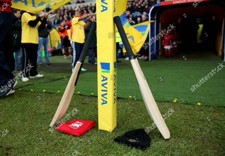 Cricket bats are left at the side of the pitch in memory of cricketer Philip Hughes.