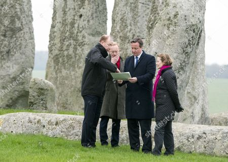 Stock Picture of Andrew Page-Dove, Regional Director of the Highways Agency, Simon Thurley (red scarf) Director of English Heritage, David Cameron and Dame Helen Ghosh, Director-General of the National Trust