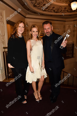 Kylie Minogue (C) poses with Thea Bregazzi and Justin Thornton, winners of the Establishment Award for Preen