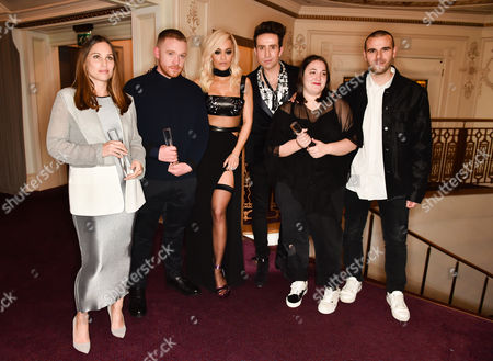 Stock Photo of Anna Laub of Prism, winner of the Emerging Accessory Designer award, Craig Green, winner of the Emerging Menswear Designer award, Rita Ora, Nick Grimshaw, and Marta Marques and Paulo Almeida of Marques'Almeida