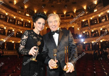 Stock Picture of Lucie Bila and Karel Gott poses with their trophy for best female and male singer