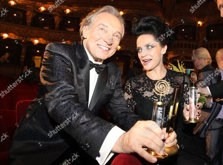 Stock Photo of Lucie Bila and Karel Gott poses with their trophy for best female and male singer
