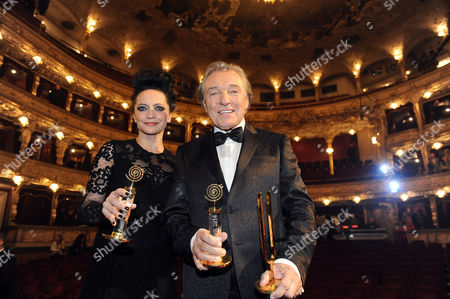 Stock Image of Lucie Bila and Karel Gott poses with their trophy for best female and male singer