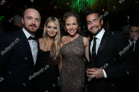 BEVERLY HILLS, CA - JANUARY 13:  Aaron Paul, Lauren Parsekian, Julie Benz, Rich Orosco at Warner Bros. /InStyle Golden Globes Party held at The Beverly Hilton Hotel on January 13, 2013 in Beverly Hills, California. (Photo by Eric Charbonneau/Le Studio)