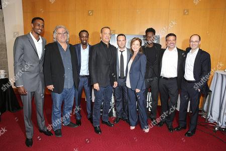 Stock Photo of Faysal Ahmed, Paul Greengrass, Barkhad Abdi, Tom Hanks, Dana Brunetti, Elizabeth Cantillon, Mahat M. Ali, Michael De Luca, Doug Belgrad