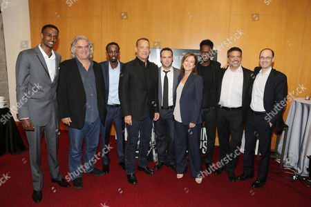 Stock Picture of Faysal Ahmed, Paul Greengrass, Barkhad Abdi, Tom Hanks, Dana Brunetti, Elizabeth Cantillon, Mahat M. Ali, Michael De Luca, Doug Belgrad