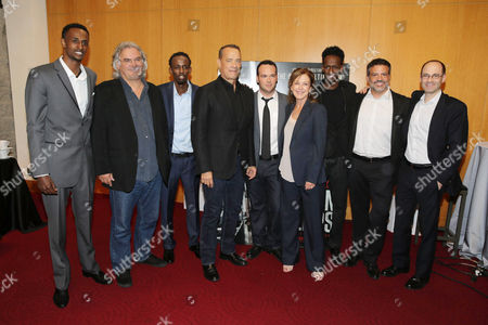 Stock Image of Faysal Ahmed, Paul Greengrass, Barkhad Abdi, Tom Hanks, Dana Brunetti, Elizabeth Cantillon, Mahat M. Ali, Michael De Luca, Doug Belgrad