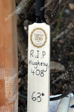A cricket bat with '408' written referring to Philip Hughes as the 408th Australian Test Cricketer and his score when he was hit of '63' not out