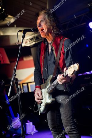 Stock Picture of Pwllheli United Kingdom - November 28: Hard Rock Guitarist Bernie Torme Performing Live On Stage At The 2013 Hard Rock Hell Festival In Pwllheli Wales On November 28