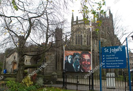 """Political mural which has been painted on the side of St John the Evangelist  church on Princes Street in Edinburgh. The artwork reads """"Evolution?"""" and shows images of the extremist leaders Adolf Hitler, Oswald Mosley, Nick Griffin from the BNP and UKIP Nigel Farage."""
