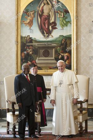 President of Mozambique Armando Guebuza and Pope Francis I in the Private Library of the Apostolic Palace