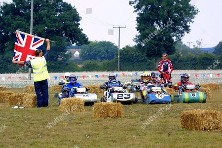 The start of a racing heat at a meeting organised by the British Lawn Mower Racing Association. The association is now in its 32nd year and started out with people running behind their mowers. It now has four different racing groups including ride on lawnmowers and tractor mowers. The association has 250 members and can boast Formula One racing legend Stirling Moss and late actor Oliver Reed among famous people who have tried the sport.