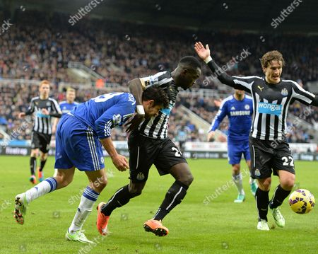 Cheik Tiote of Newcastle United grapples with Diego Costa of Chelsea