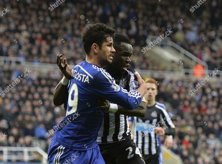 Diego Costa of Chelsea and Cheik Tiote of Newcastle United grapple with each other in the penalty box