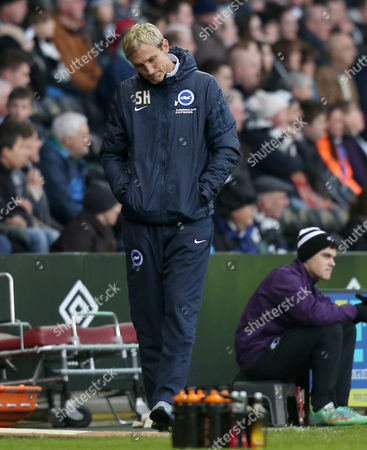 Brighton and Hove Albion's manager Sami Hyypia looks down